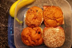 Lunchbox with four buns and a banana