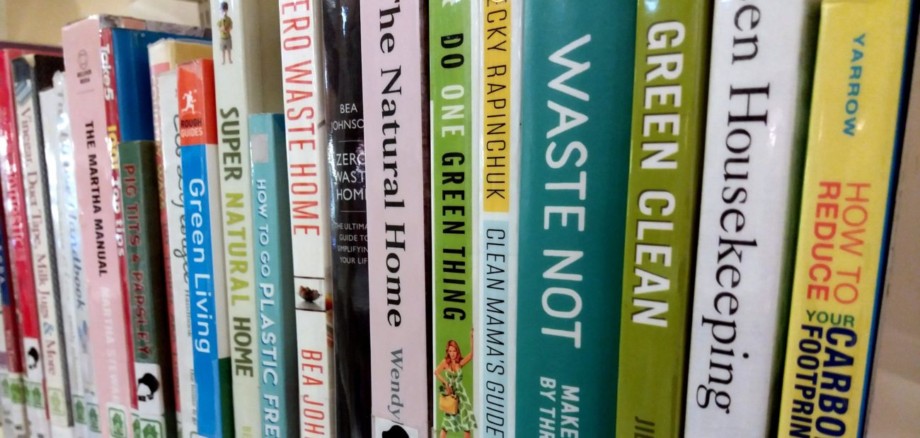 lineup of books about green living and sustainability on a library shelf
