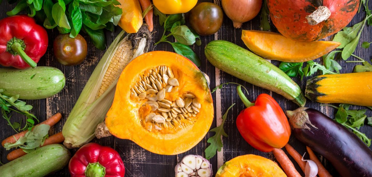 Colourful vegetables on a wooden table