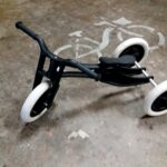 black child's tricycle