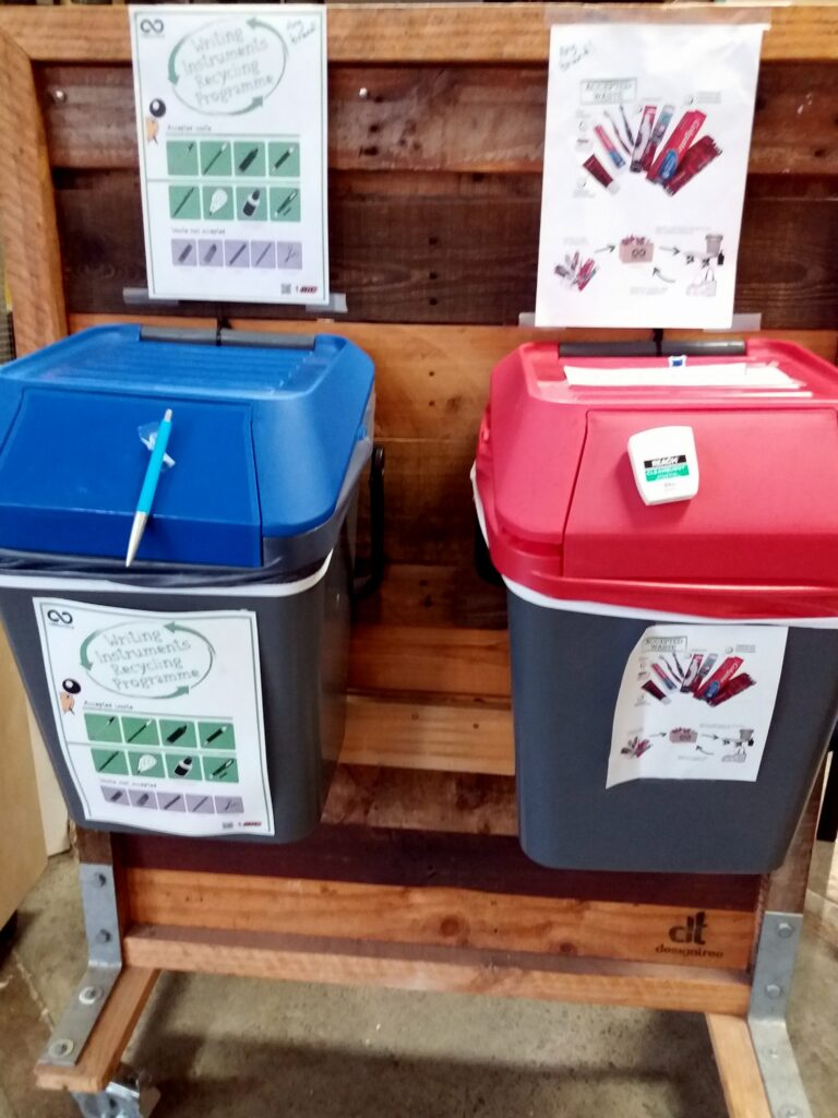 Recycling bins for writing material and oral care products