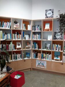 Library displaying books about waste minimisation and sustainability